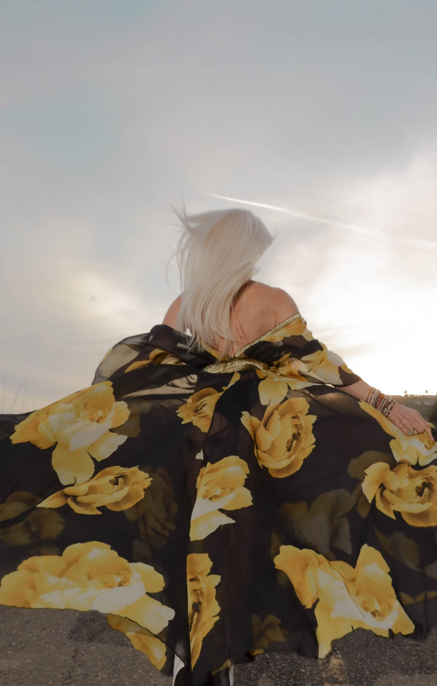 mental health blog post, embracing turning 60, silver haired model, inclusive model, yellow and black print dress